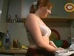 Cute pale redhead cummed on in the kitchen