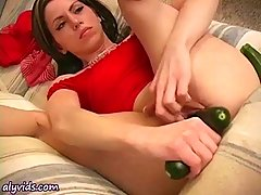 Babe inserting three cucumbers