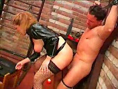 Mature Dominatrix uses her
