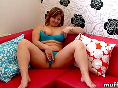 Marie Jeanne masturbates on red sofa