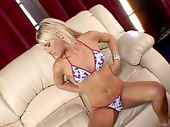 Hot blonde with big wet pussy masturbates on the sofa