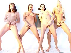 Four pretty lesbians licking each other