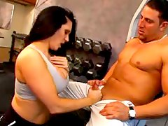 Muscular babe and her man fuck in gym