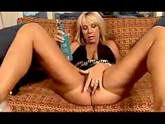Horny blonde humping huge dildos