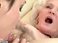 Granny and young lady lick