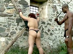 Slave gets tied up and ass spanked by this