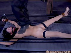 brunette is under the feet of her punisher Nyssa Nevers