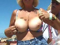 tattooed mature shows nipples and posi..